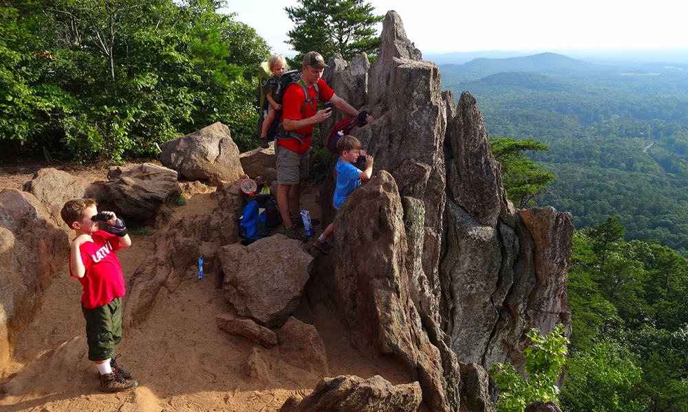 Family looking over Crowders Mountain