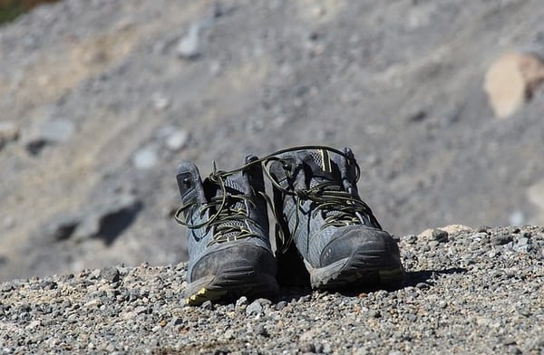 Denali hiking boots placed on the rock land