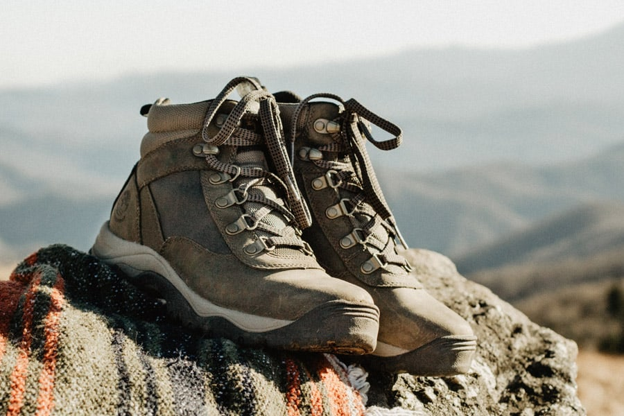 Pair of hiking boots on top of the stone